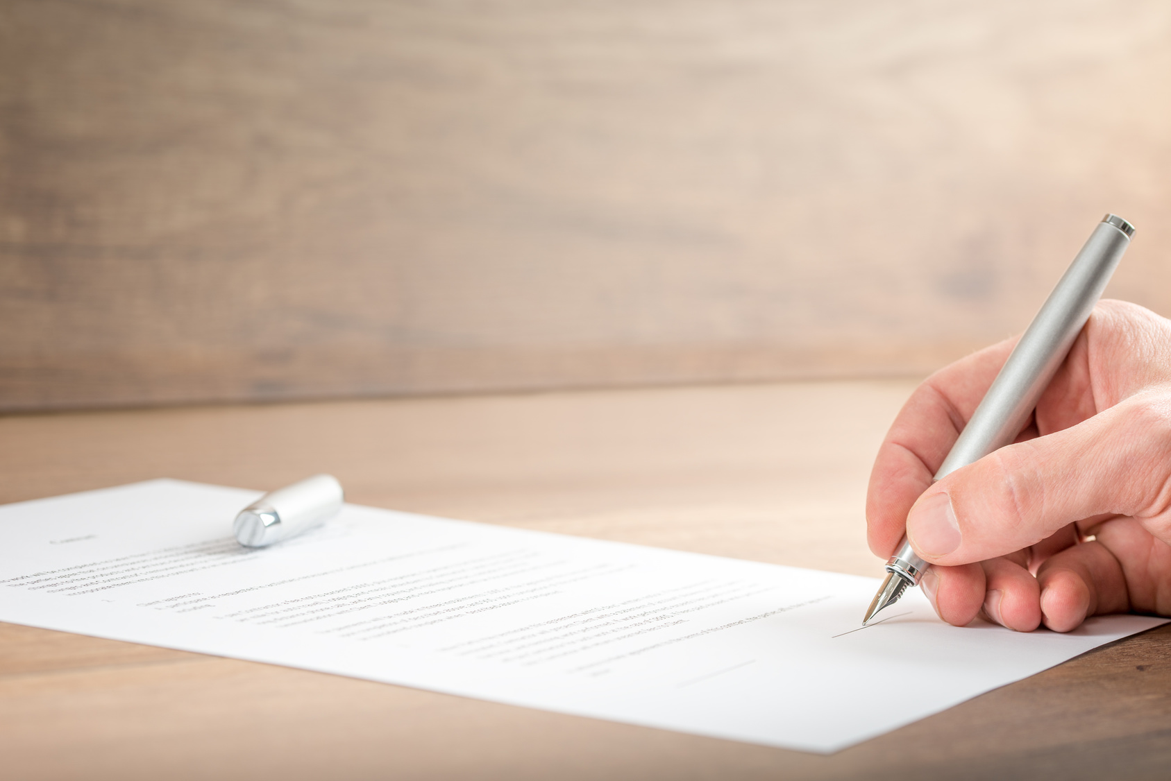 Close up Businessman Signing a Contract Document
